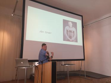 Jón Gnarr shows his pirate-tattoo as he tells about his fictional biography